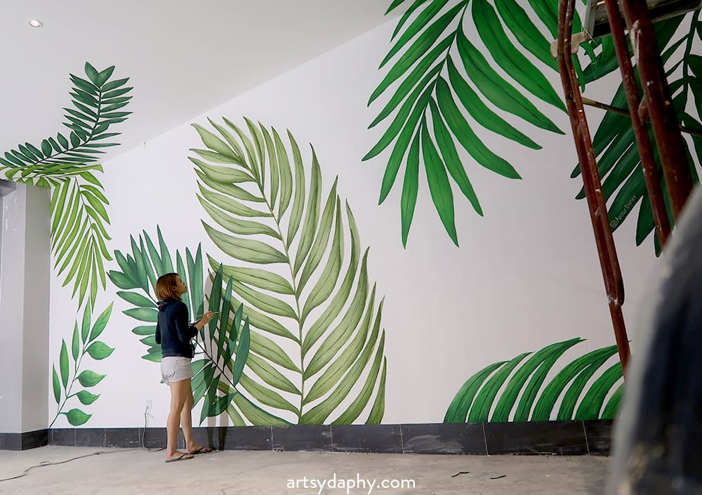 Artsy Daphy painting Kuching mall leaves mural