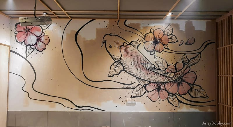 abstract two colour Japanese koi fish mural floating amongst flowers