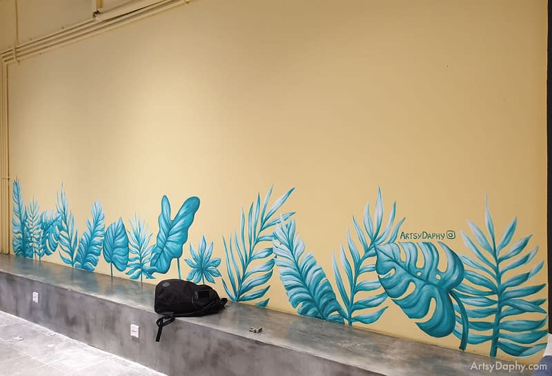 tropical leaves mural at Ono Poke bowl store in Kuching