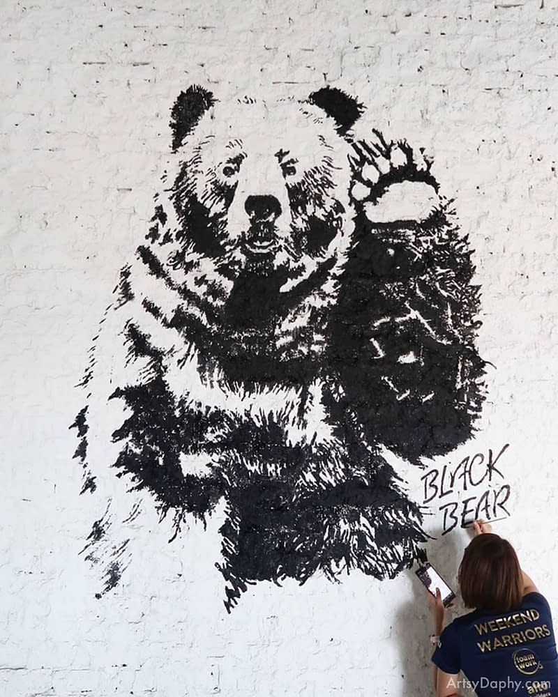 yunique black and white bear mural on cafe brick wall painting