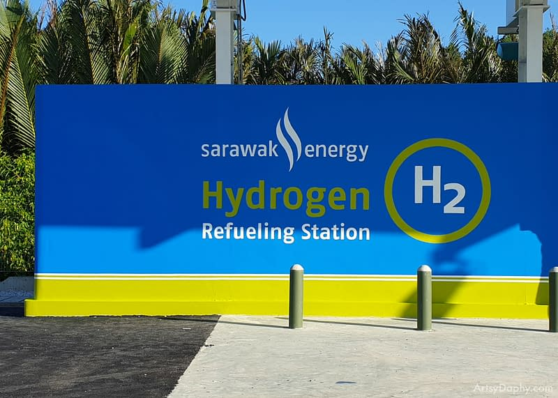 """wall with the painting that says """"Sarawak Energy Hydogen Refuelling Station"""""""