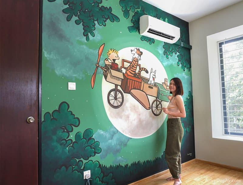 Artsy Daphy painting Calvin & Hobbes kids room mural