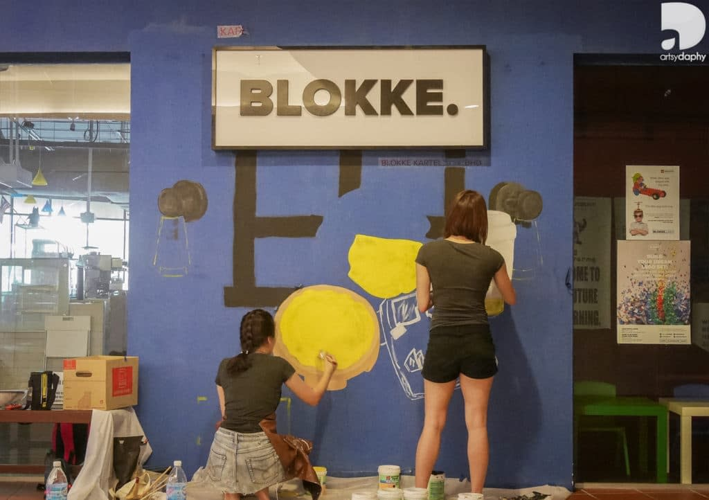 Process painting of Blokke Citta Mall Lego inspired murals by Artsy Daphy
