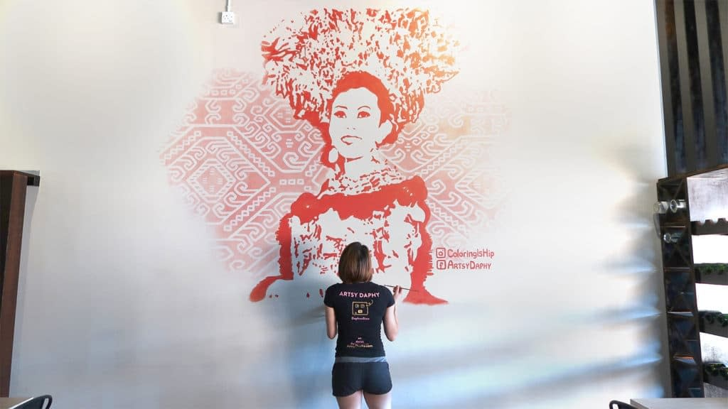 Amazing Woman wearing Sarawak Iban Costume Mural size comparison with human