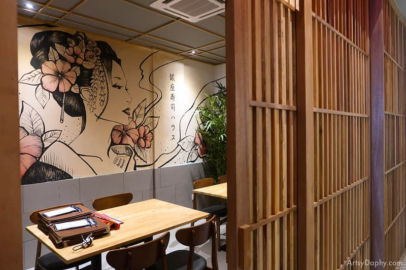 Japanese Woman painting seen behind the fancy wooden V.I.P room doors of Ginza Japanese Restaurant