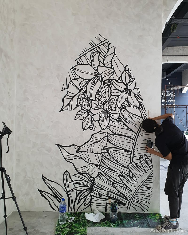 hand painted flower mural art before neon lights and typography are fixed on