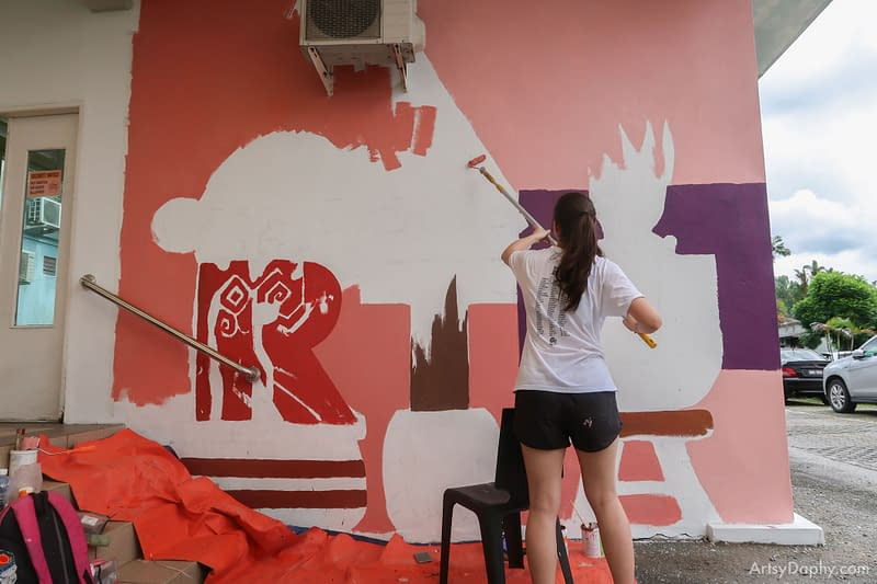 Painting the wall art at Sarawak General Hospital RTU