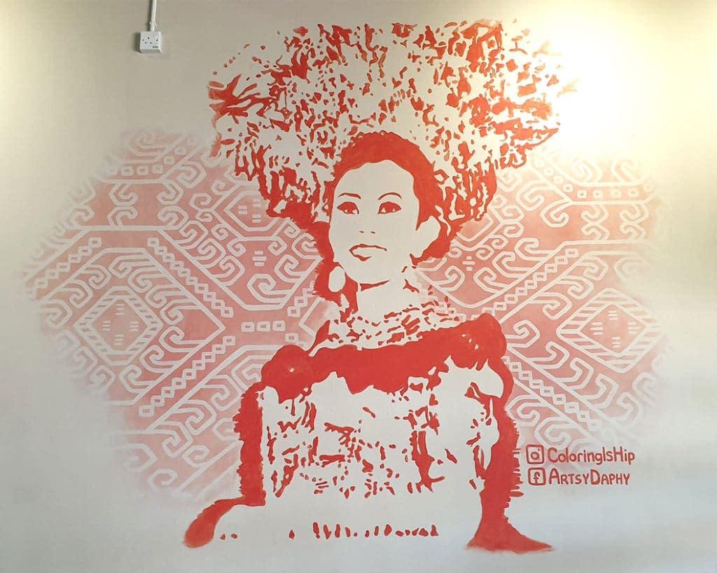 Beautiful Sarawak Iban Costume Mural with Pua Kumbu background at Black Jam restaurant