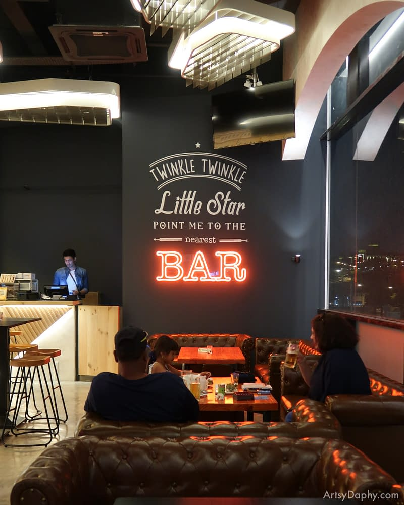typography with neon lights at a bar saying 'twinkle twinkle little star, point me to the nearest BAR'
