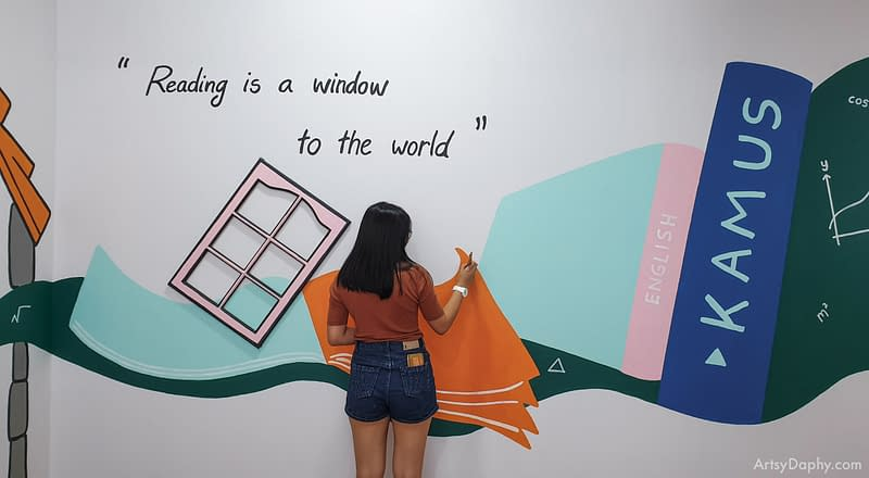 "giant abstract books mural with the quote ""reading is a window to the world"""