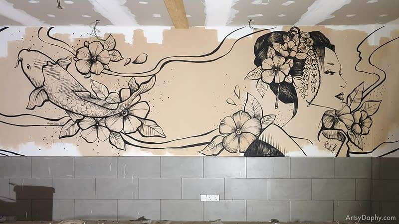 Abstract mix comic painting of a koi fish and Japanese woman on a restaurant wall under renovation