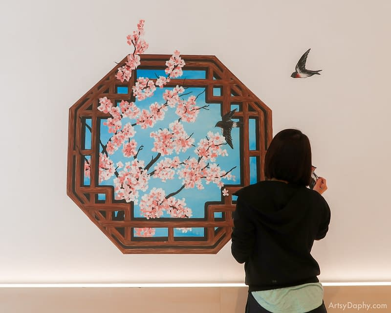 Chinese window with cherry blossoms and birds painted at HappiNest bird nest dessert store