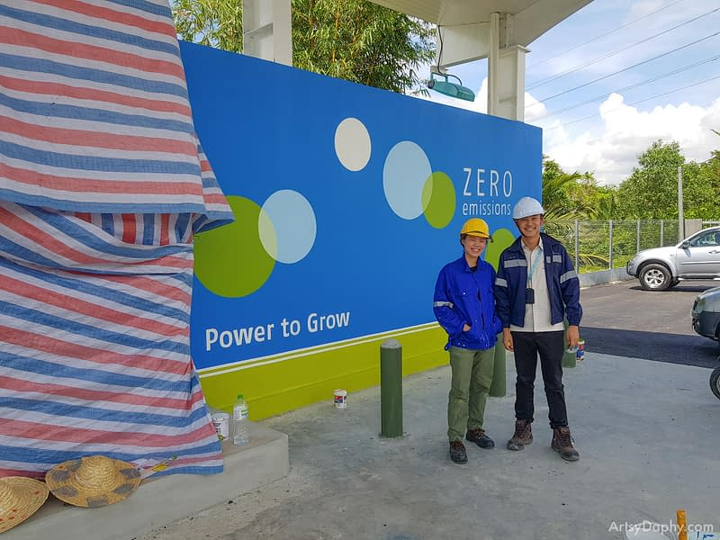 engineer and Artsy Daphy posing with the completed hydro fuel cell refuelling station at Sarawak Energy