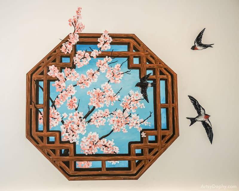 Cherry blossom peeping out of the window with birds flying in and out at bird nest dessert store